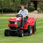The Westwood Powered Grass Collector uses brushes to sweep grass clippings from the lawn